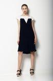 Full Portrait of Elegant Refined Female in Urban Black - White  Dress. Fashion Stock Photos