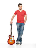 Full portrait of handsome man with   electric guitar Royalty Free Stock Photos