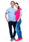 Full portrait of happy attractive couple. Full portrait of happy attractive couple isolated on white background Royalty Free Stock Photography