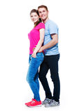 Full portrait of happy attractive couple. Full portrait of happy attractive couple isolated on white background Stock Photo