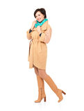Full portrait of happy woman in fall coat with green scarf Stock Image