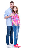 Full portrait of happy young couple. Full portrait of happy young couple isolated on white background stock images