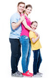Full portrait of the happy young family. Stock Photos