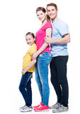 Full portrait of the happy young family. Stock Image