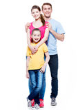 Full portrait of the happy young family. Royalty Free Stock Photography