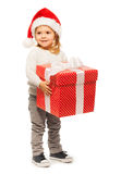 Full portrait of little girl with big present Royalty Free Stock Photography
