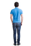 Full portrait of man standing back in casuals. royalty free stock photography