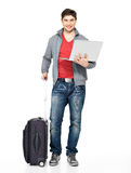 Full portrait of man with suitcase and laptop Royalty Free Stock Photography