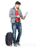 Full portrait of man with suitcase and laptop Royalty Free Stock Photos