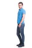 Full portrait of smiling happy handsome man in blue jeans. Royalty Free Stock Photo