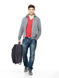 Full portrait of smiling happy man with suitcase Stock Images