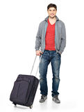 Full portrait of smiling happy man with suitcase Stock Photos