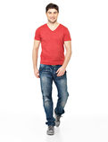 Full portrait of smiling  walking man. In red t-shirt casuals  isolated on white background Stock Photos