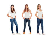 Full portrait of three casual girls with jeans and white tshirts Royalty Free Stock Images