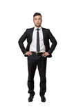 Full portrait of young business man, put his hands on waist, isolated, white background Stock Photography