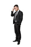 Full portrait of young man in business suit, thinking about something, isolated on a white background Stock Image