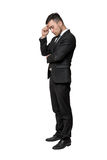Full portrait of young man in business suit, thinking about something, isolated on a white background Royalty Free Stock Images