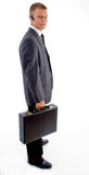 Full pose of young executive holding briefcase Stock Images