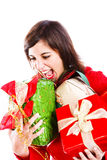Full Of Presents Joy. Cheerful Young Woman Holding A Bunch of Presents Stock Image