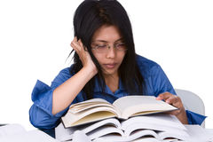 Full pressured. A student is very exhausted while there are still more books to learn Stock Image
