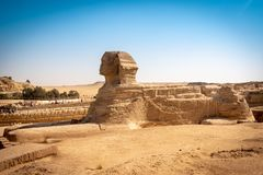 The full profile of the Great Sphinx with the pyramid in the background in Giza. Egypt. stock images