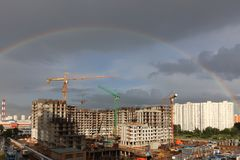 Full rainbow over the construction site Stock Images