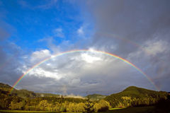 Full Rainbow Over Forest Hills Stock Photography