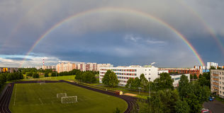 Full 180 rainbow over residental part of Tallinn city, Estonia.  Royalty Free Stock Photo
