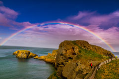 Full Rainbow at Rope Bridge, North Ireland. Royalty Free Stock Photo