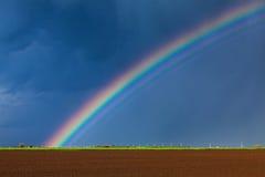 Full rainbow spectrum. Full rainbow color spectrum during storm Royalty Free Stock Photo