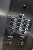 Full ram av numrerade knappar med blindskrift Arkivbild