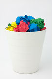 Full recycle bin by multicolor paper ball Stock Photo