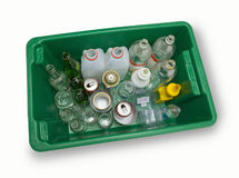 Full Recycling Bin. A green recycling bin full of glass, plastic and metal containers Stock Image
