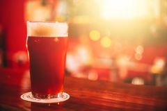 Red ale. Full red ale mug on the bar. Copy space Royalty Free Stock Images