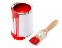Full of red paint tin near the paintbrush Stock Image