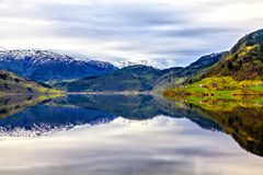The full reflection of the landscape on the surface of the water Royalty Free Stock Image