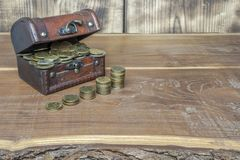 A full retro suitcase of gold and silver coins royalty free stock images
