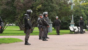 Full riot gear stand in a city park, Russia Royalty Free Stock Images