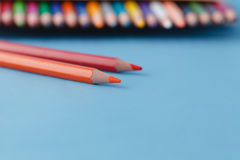 Full row of multycolor pencils on blue background Stock Photo