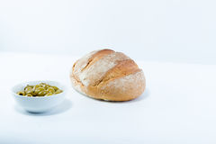 Full rustic crusty loaf of bread with fresh olives isolated on w Royalty Free Stock Photography