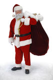Full Santa. Full length Santa standing in snow with sack of toys on a white background Royalty Free Stock Image