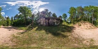 Full seamless 360 degrees angle view panorama on the ruined abandoned military fortress of the First World War in the forest in stock images