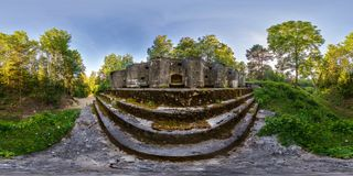 Full seamless panorama 360 angle view battle position on abandoned military fortress of the First World War in forest in rays of. Setting sun in equirectangular stock images