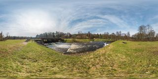 Full seamless panorama 360 angle view dam lock sluice on the lake impetuous waterfall in sunny day. Skybox as background in royalty free stock photo