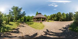 Full seamless panorama 360 by 180 angle view on gazebo in the park dendro in equirectangular equidistant projection, skybox VR. Content royalty free stock photo