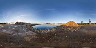 Full seamless panorama 360 angle view near quarry flooded with water for sand extraction mining in equirectangular spherical stock photos