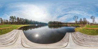 Full seamless panorama 360 angle view with white steamer on boat station on lake in sunny day. Skybox as background in royalty free stock images