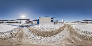 Full seamless panorama 360 angle view in winter snow field place site construction of a mining plant in equirectangular. Equidistant spherical projection, VR stock photo