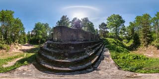 Full seamless panorama 360 by 180 degrees angle view ruined abandoned military fortress of the First World War in forest in royalty free stock photo