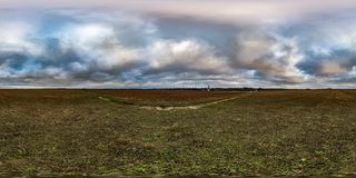 Full seamless spherical hdri panorama 360 degrees angle view among fields in autumn overcast evening  in equirectangular